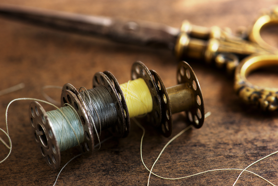 Vintage sewing machine bobbins with vintage gold ( brass ) sciss