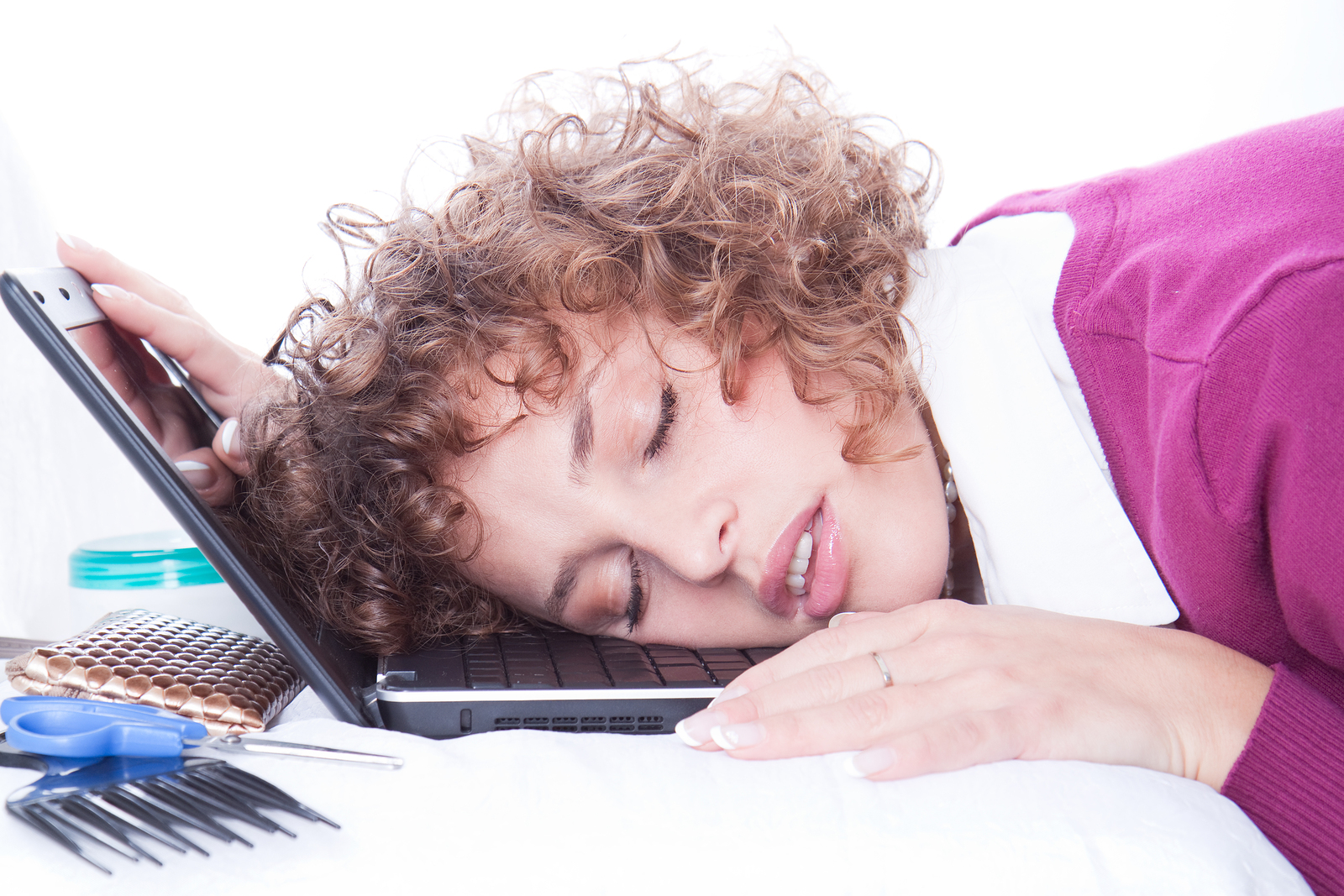 Tired overworked business woman sleeps on laptop in office